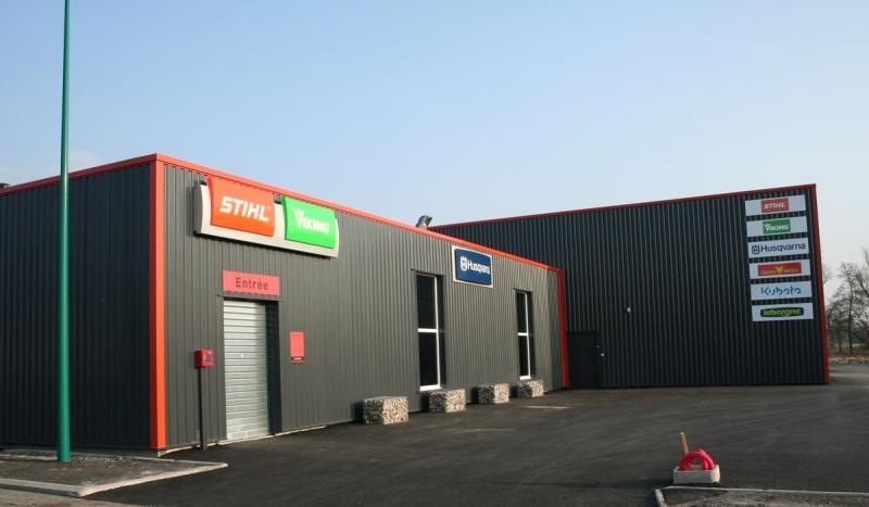 Surface commerciale et atelier de réparation